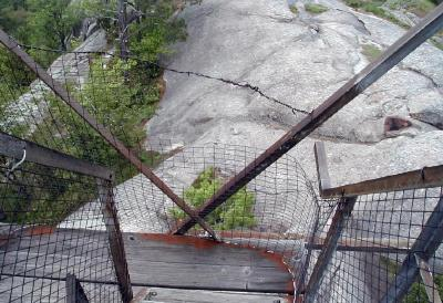 Torn security fencing and unstable landings